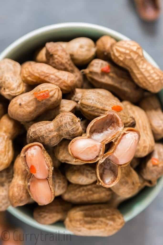 soft instant pot boiled peanuts with shell opened on few nuts in bowl