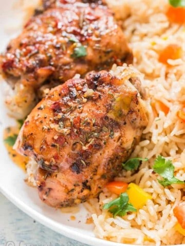 cajun spiced instant pot chicken and rice served on white plate