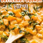 Thai butternut squash curry in skillet with wooden spatula with text