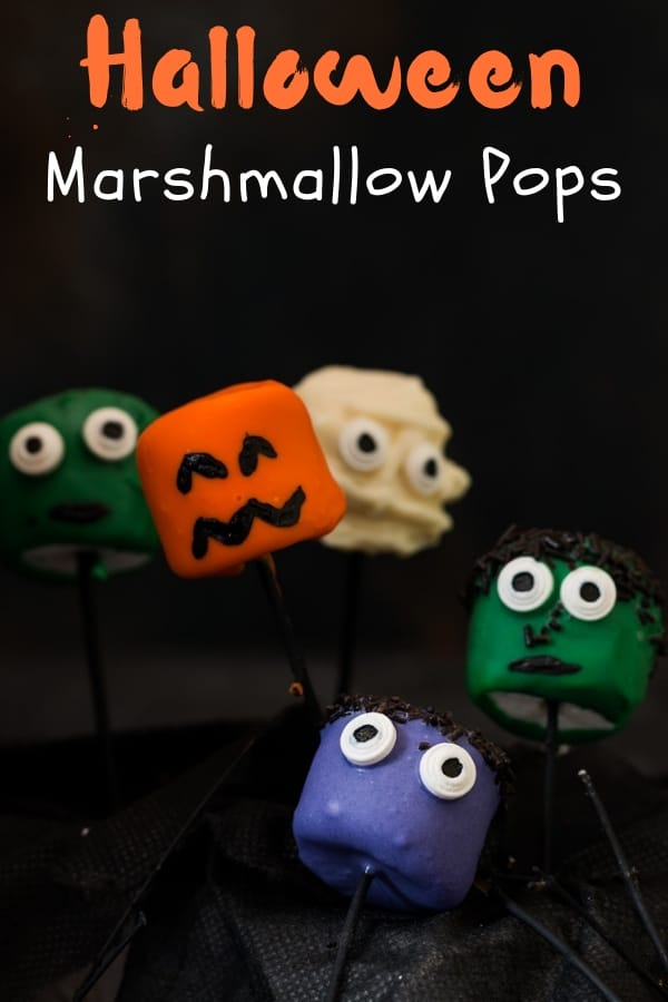 halloween marshmallow pops with text overlay