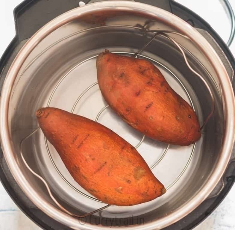 prep work for instant pot sweet potatoes two sweet potatoes placed in instant pot
