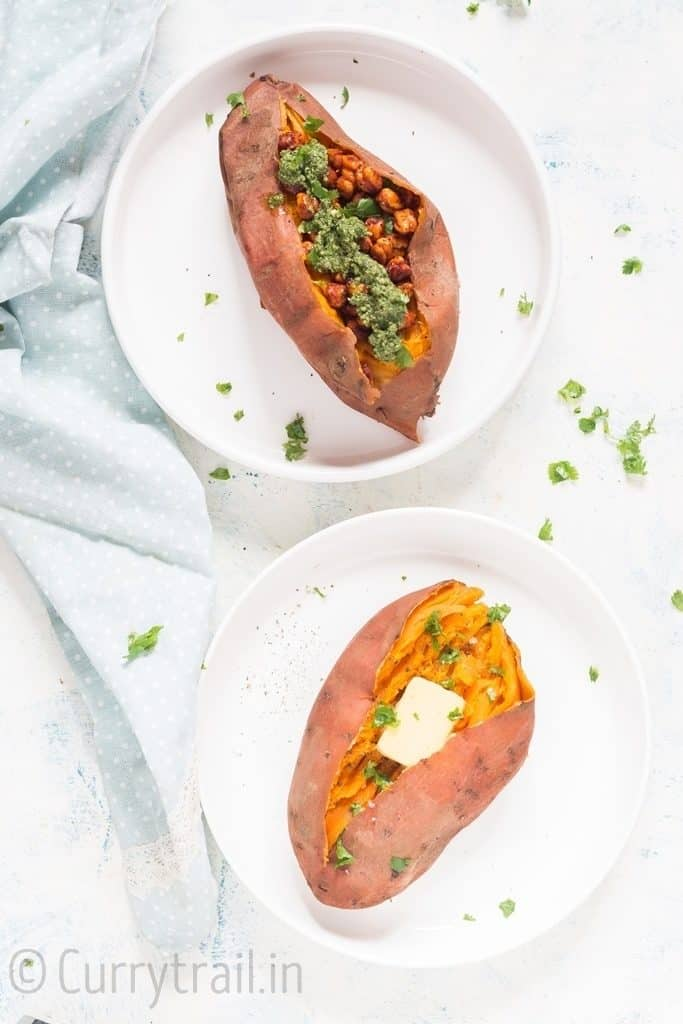two instant pot sweet potatoes on white plates mashed and stuffed with spicy chickpea filling and cubes of butter