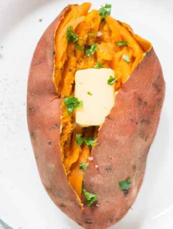 steamed and mashed sweet potatoes served with butter cube and sprinkle with cilantro