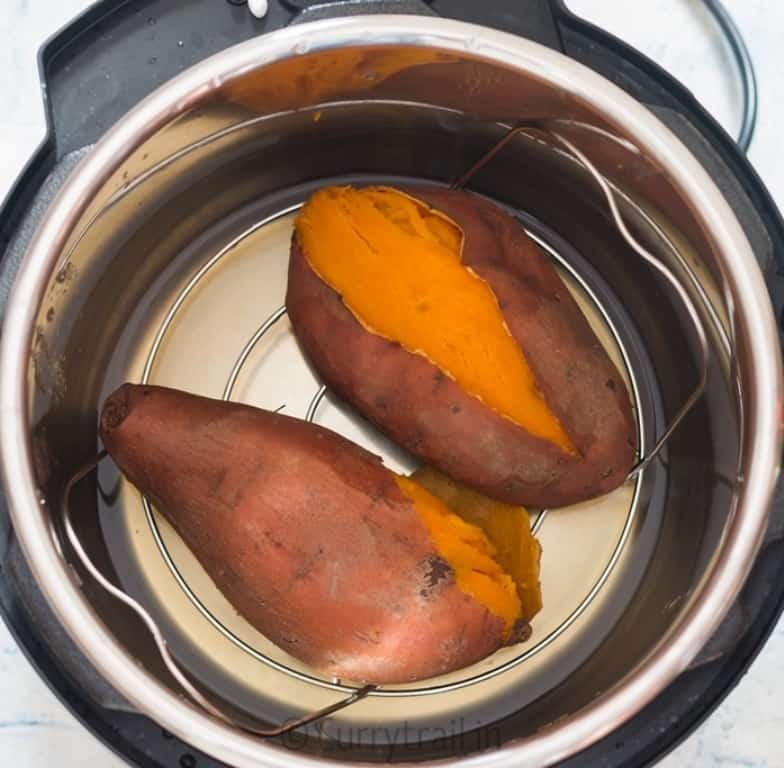 two steamed sweet potatoes placed in instant pot