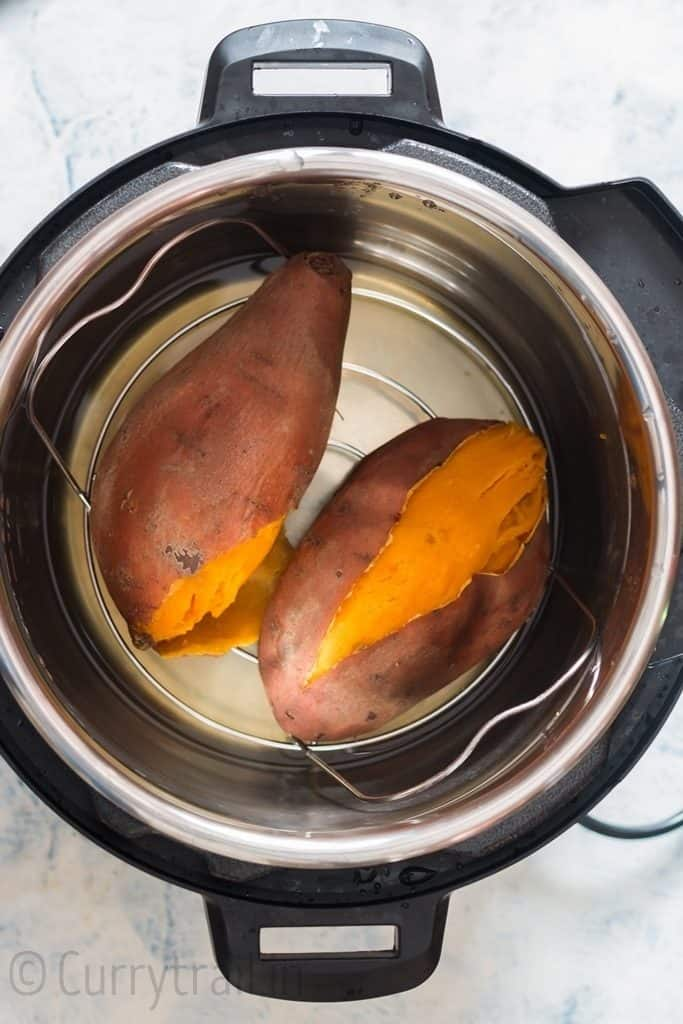 two sweet potatoes inside the pot