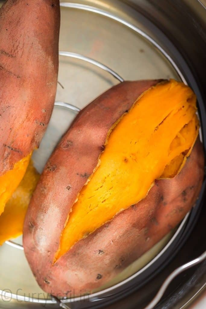 close up view of steamed instant pot sweet potatoes inside the pot