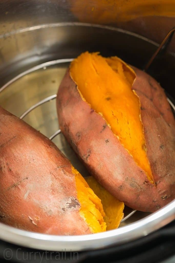 two steamed sweet potatoes inside the pot