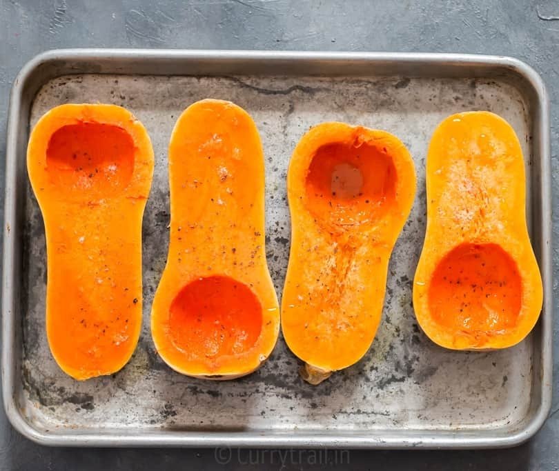 Sprinkled olive oil, salt and pepper for roasting butternut squash