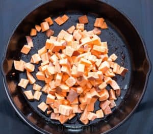 Sweet potatoes cooked in cast iron pan