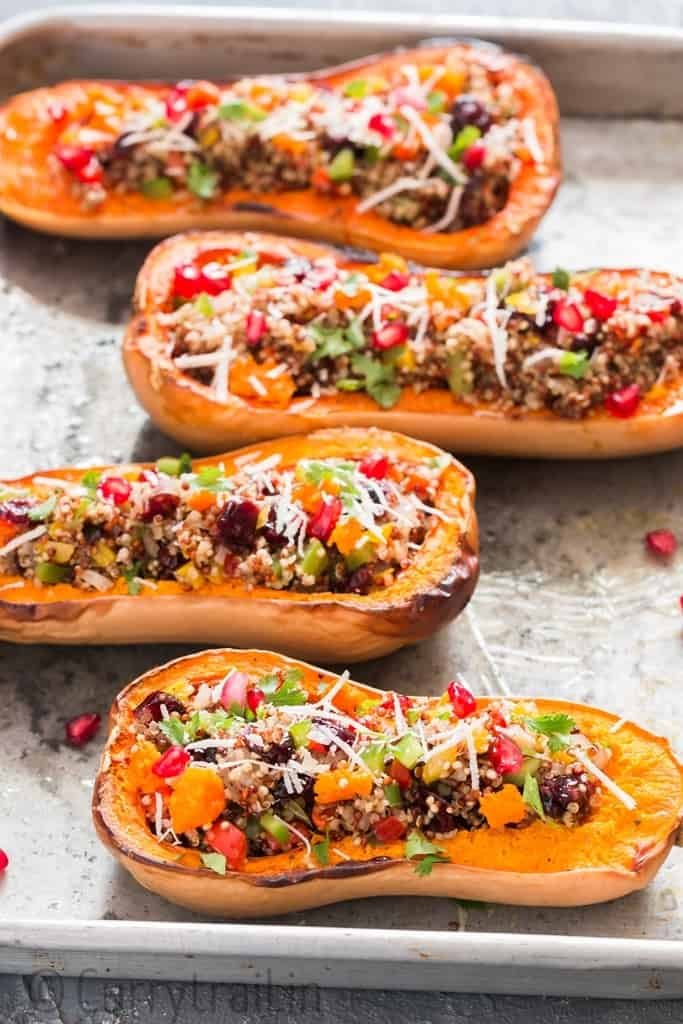 Stuffed butternut squash with quinoa arranged on baking tray