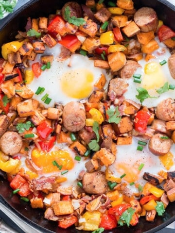 sweet potato hash with sausages and eggs