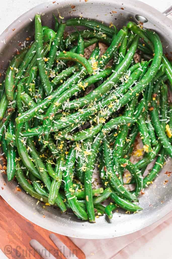 garlic sauteed green beans sprinkled with Parmesan and lemon zest cooked in skillet