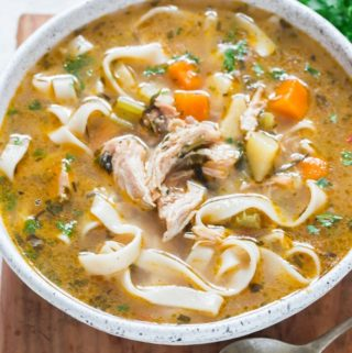 instant pot chicken noodles soup in white bowl