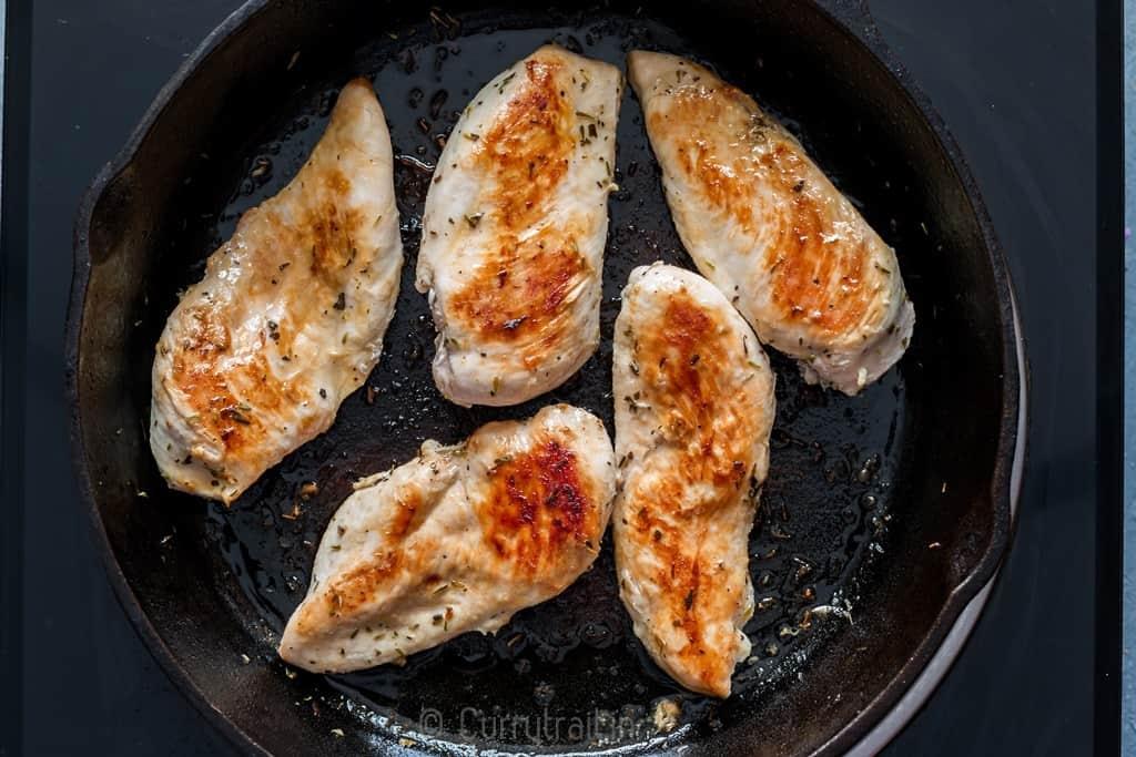 Marinated lemon chicken on cast iron pan