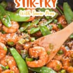 stir fried shrimp with snow peas cooked in skillet with text overlay
