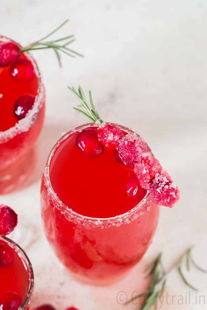 cranberry margaritas in 3 serving glasses