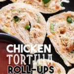 enchilada roll ups served with sauce on black plate with text