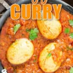 spicy egg curry in black bowl with text