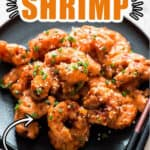 bang bang shrimp on black plate with chopsticks with text overlay