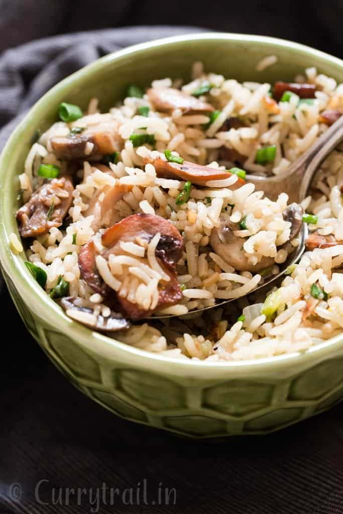 one pot mushroom rice in ceramic bowl