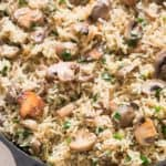 one pot mushroom rice cooked in cast iron skillet