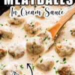 juicy chicken meatballs in white sauce in cast iron pan with text