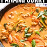chicken panang curry in cast iron pan with text