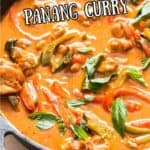 Thai chicken panang curry in cast iron skillet with text