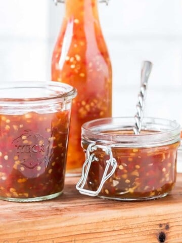 homemade spicy sweet chili sauce in 3 glass containers