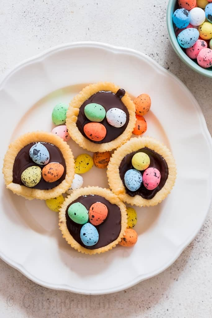 Easter mini cheesecake with dark chocolate and chocolate eggs on top