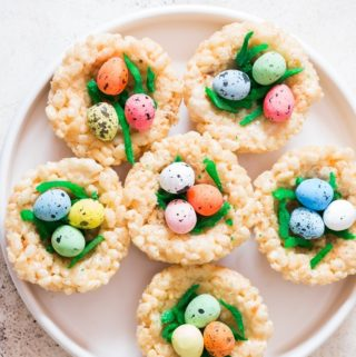 Easter Rice Krispie Treats Birds Nests topped with colored coconut flakes and Easter eggs