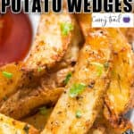 crispy baked potato wedges with tomato sauce with text overlay