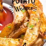 baked potato wedges served with ketchup on plate