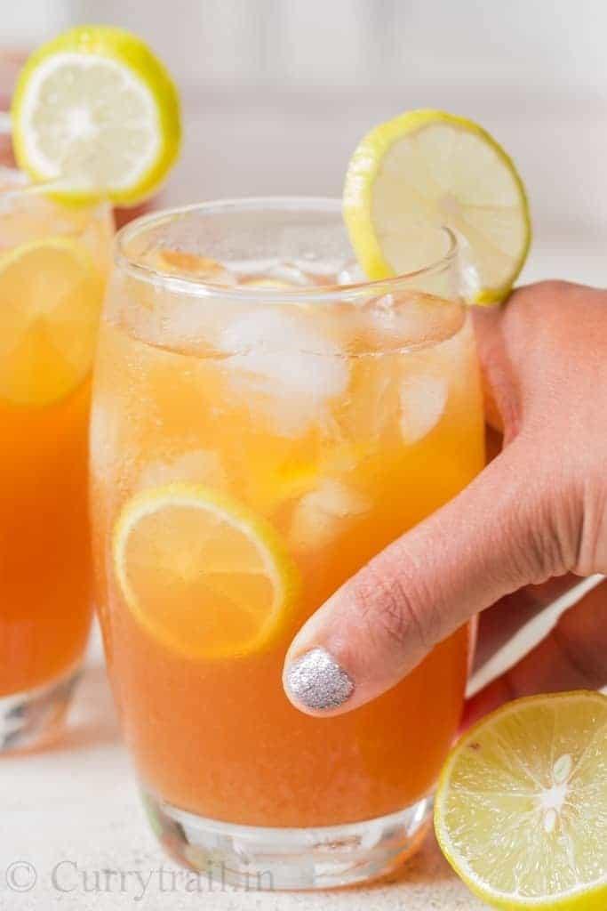 best lemon iced tea recipe garnished with lemon slices