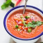 healthy cold watermelon gazpacho soup served in white bowl
