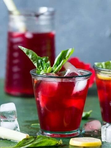 iced hibiscus tea in 2 glasses