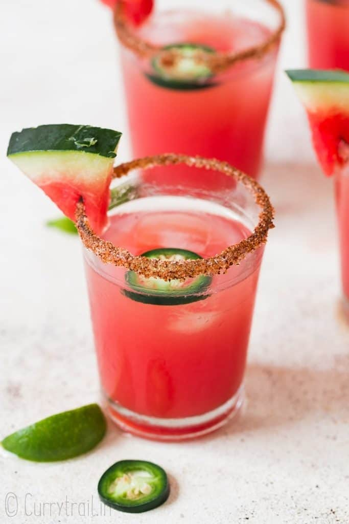 spicy watermelon margarita with sliced jalapenos