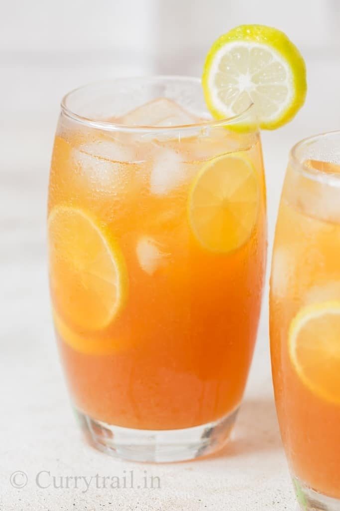 refreshing lemon iced tea served with ice cubes and lemon slices