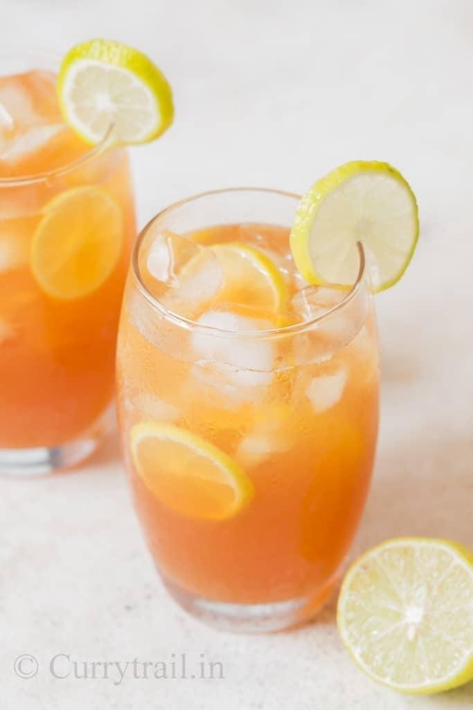 summer cool sweet lemon iced tea recipe served with lemon slices