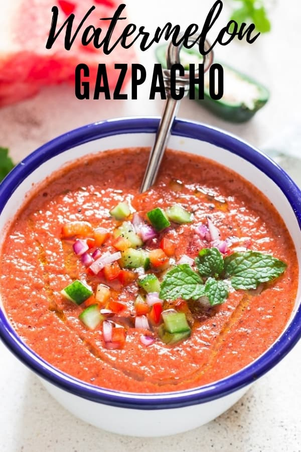 healthy cold watermelon gazpacho soup served in white bowl with text overlay