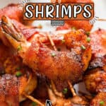 bacon wrapped shrimp served with spicy dipping sauce served on white plate with text