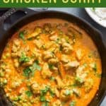 easy to make chicken curry with green peas in cast iron pan with text overlay