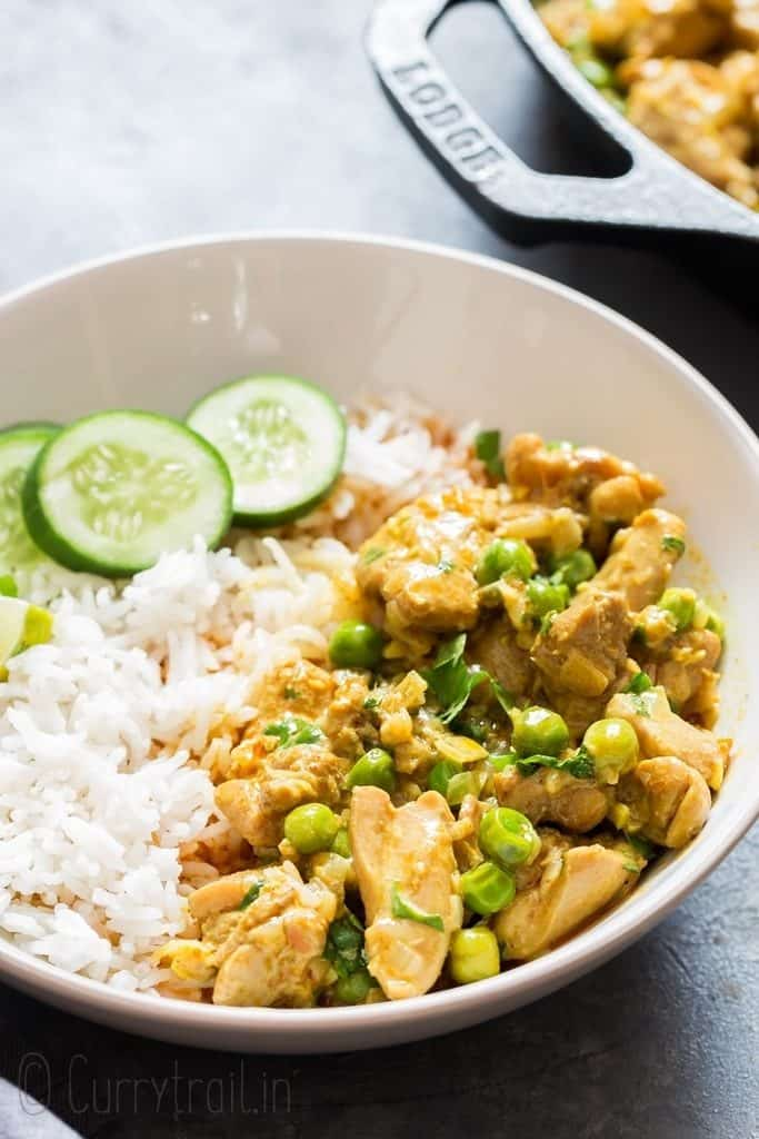 chicken curry served over rice in white bowl