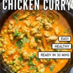 chicken curry in cast iron pan with text overlay