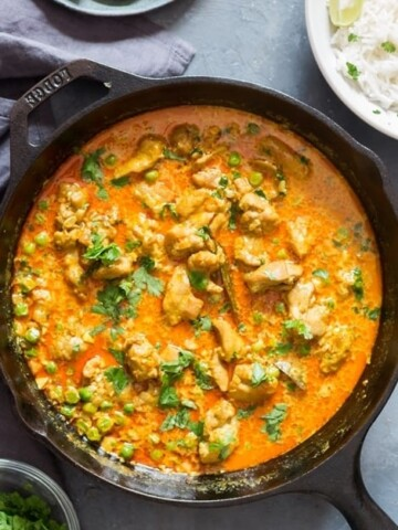chicken curry in cast iron pan