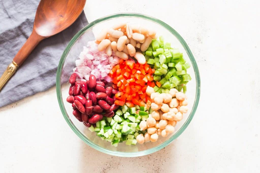 all salad ingredients for 3 bean salad in a bowl