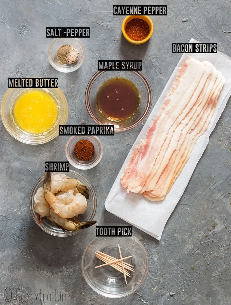 ingredients for bacon wrapped shrimp recipe lined up on grey board