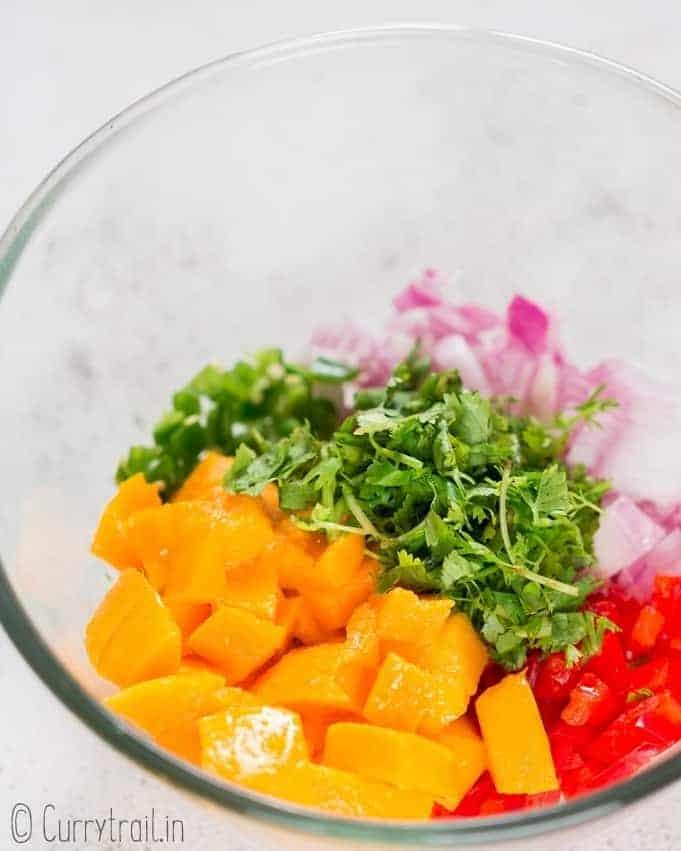 prepping mango salsa in bowl