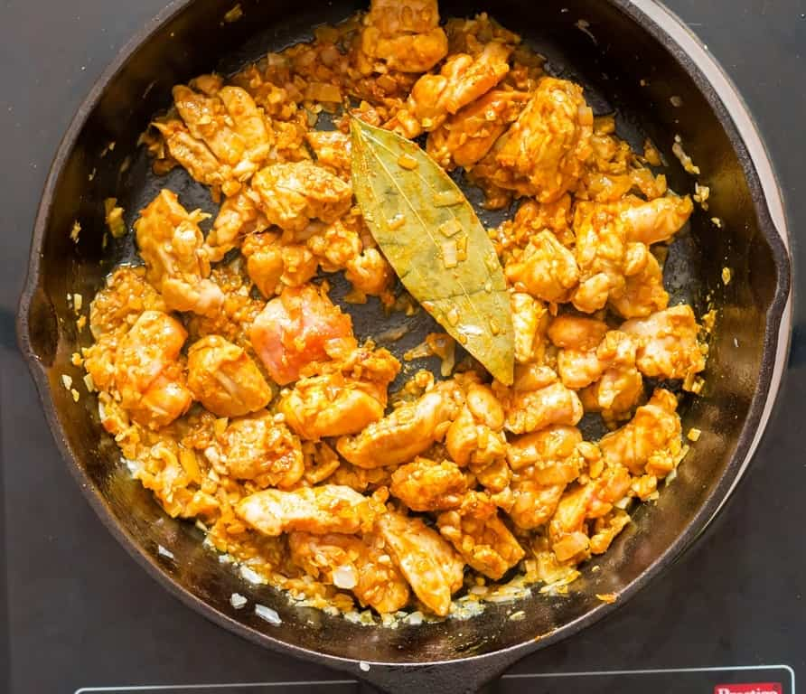 curry powder coconut chicken curry cooked in cast iron pan