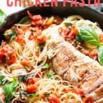 bruschetta chicken pasta in cast iron pan with napkin with text overlay